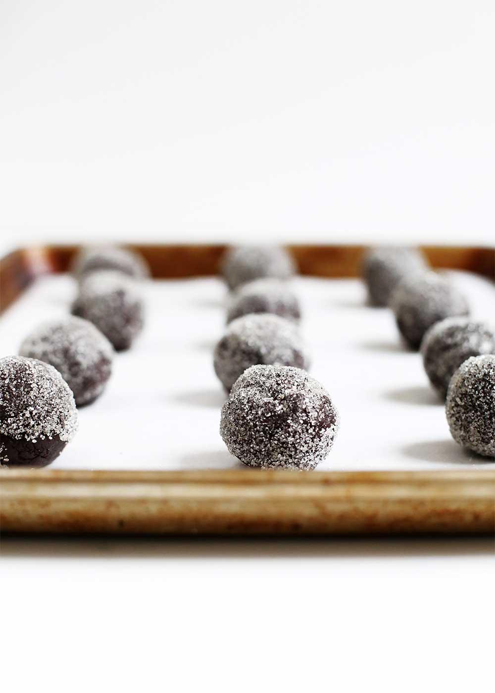 bittersweet black cookies rolled in sugar