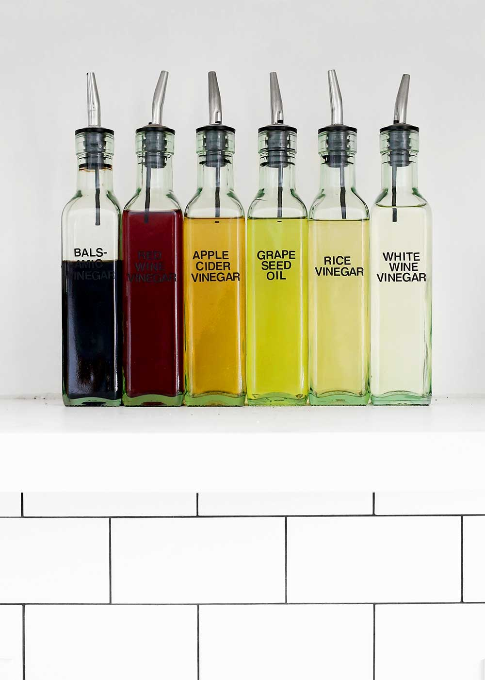 Organized oil and vinegar bottles from The Fauxmartha