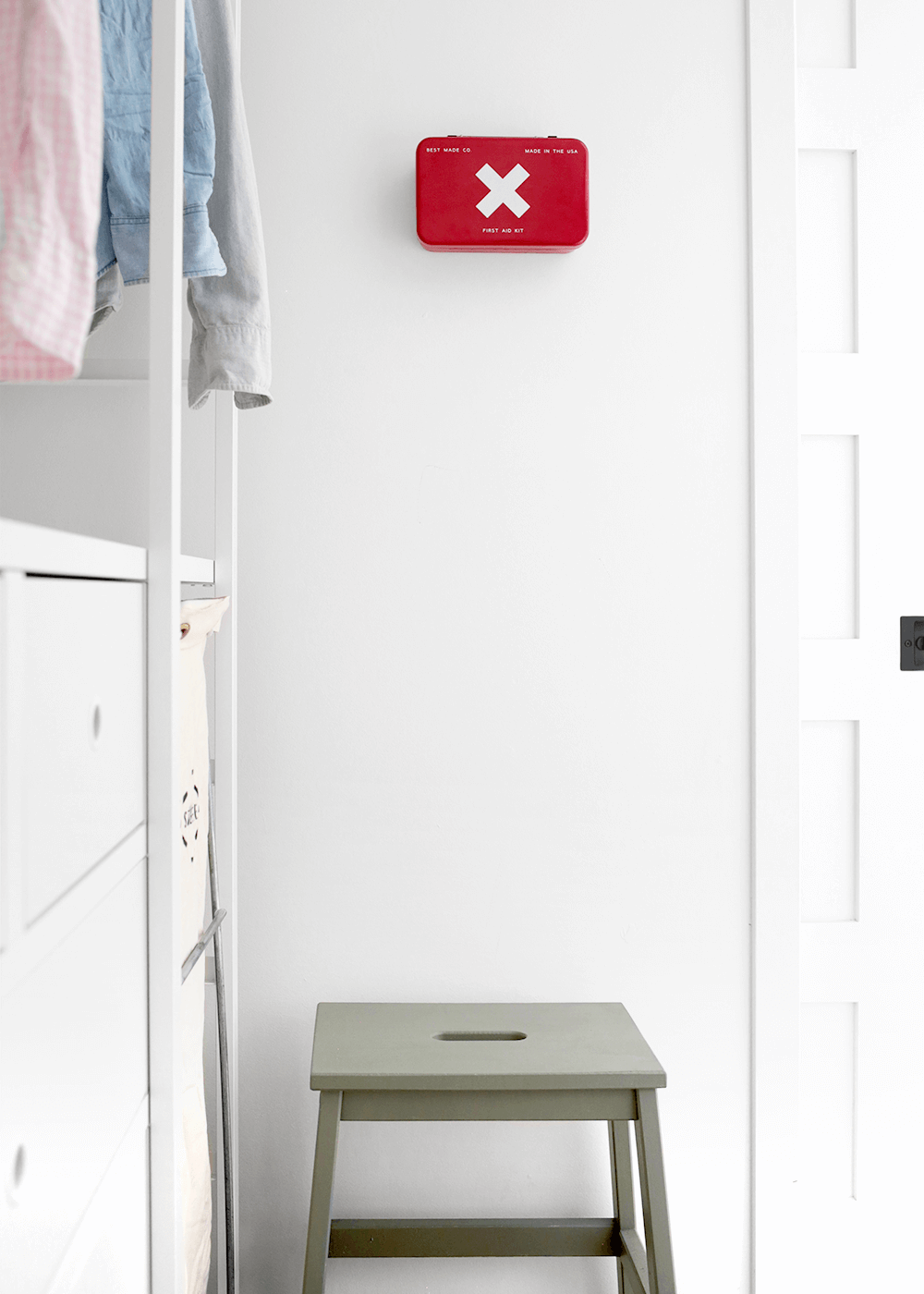 The Faux Martha laundry room with red medical kit
