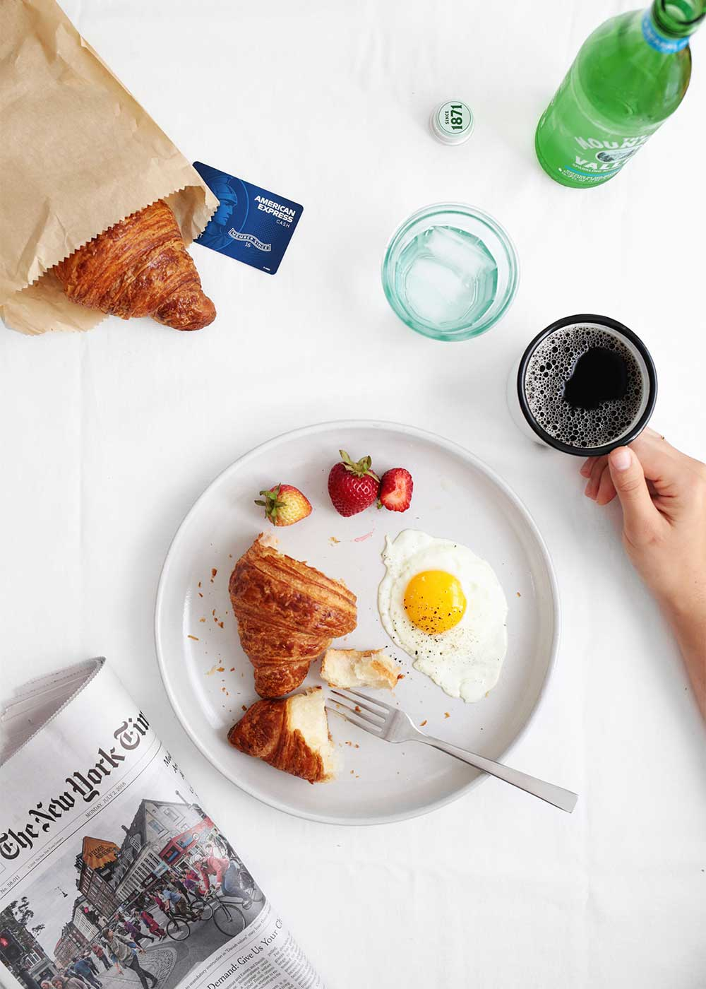 Breakfast scene with croissant and egg