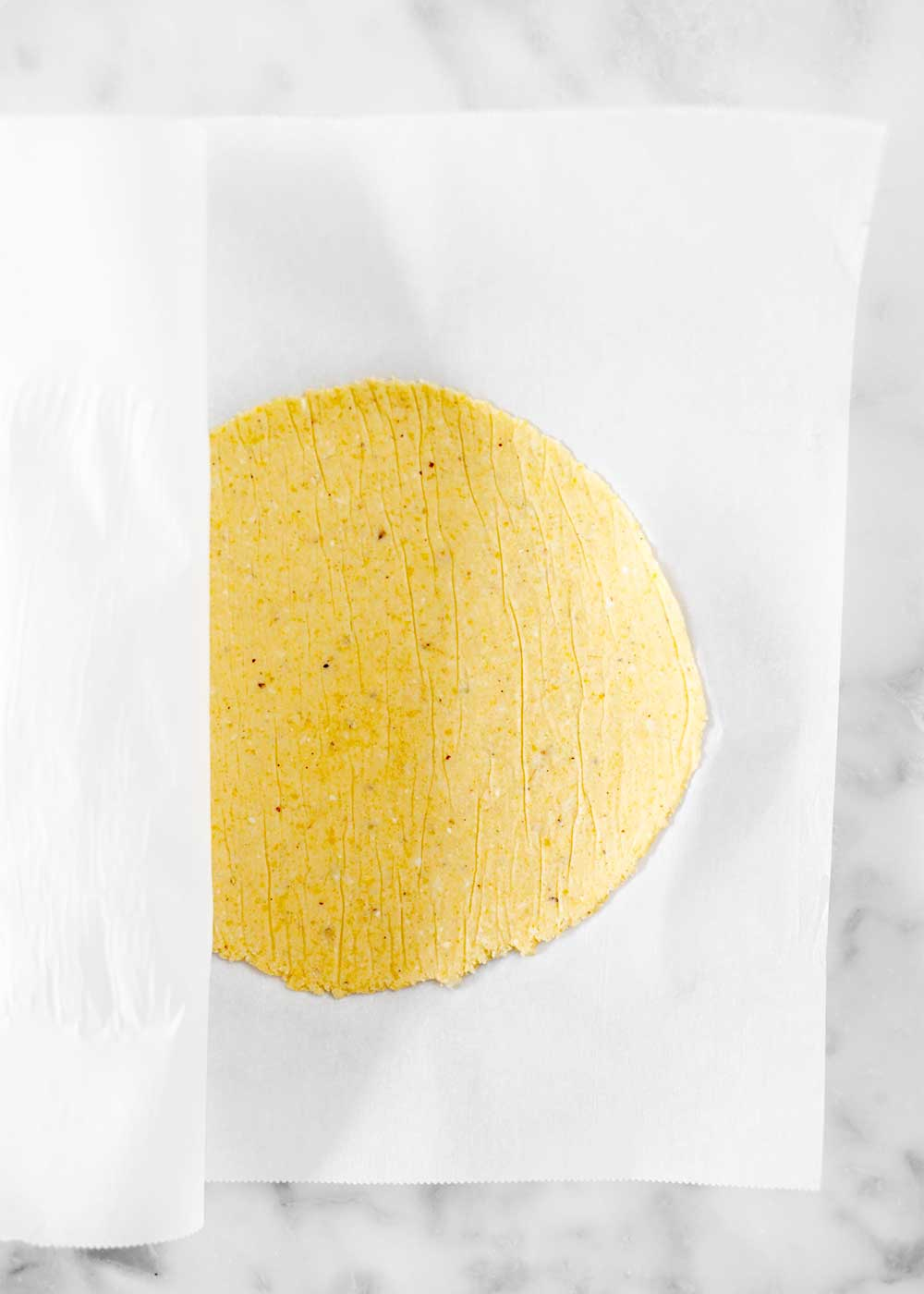 corn tortilla in parchment paper