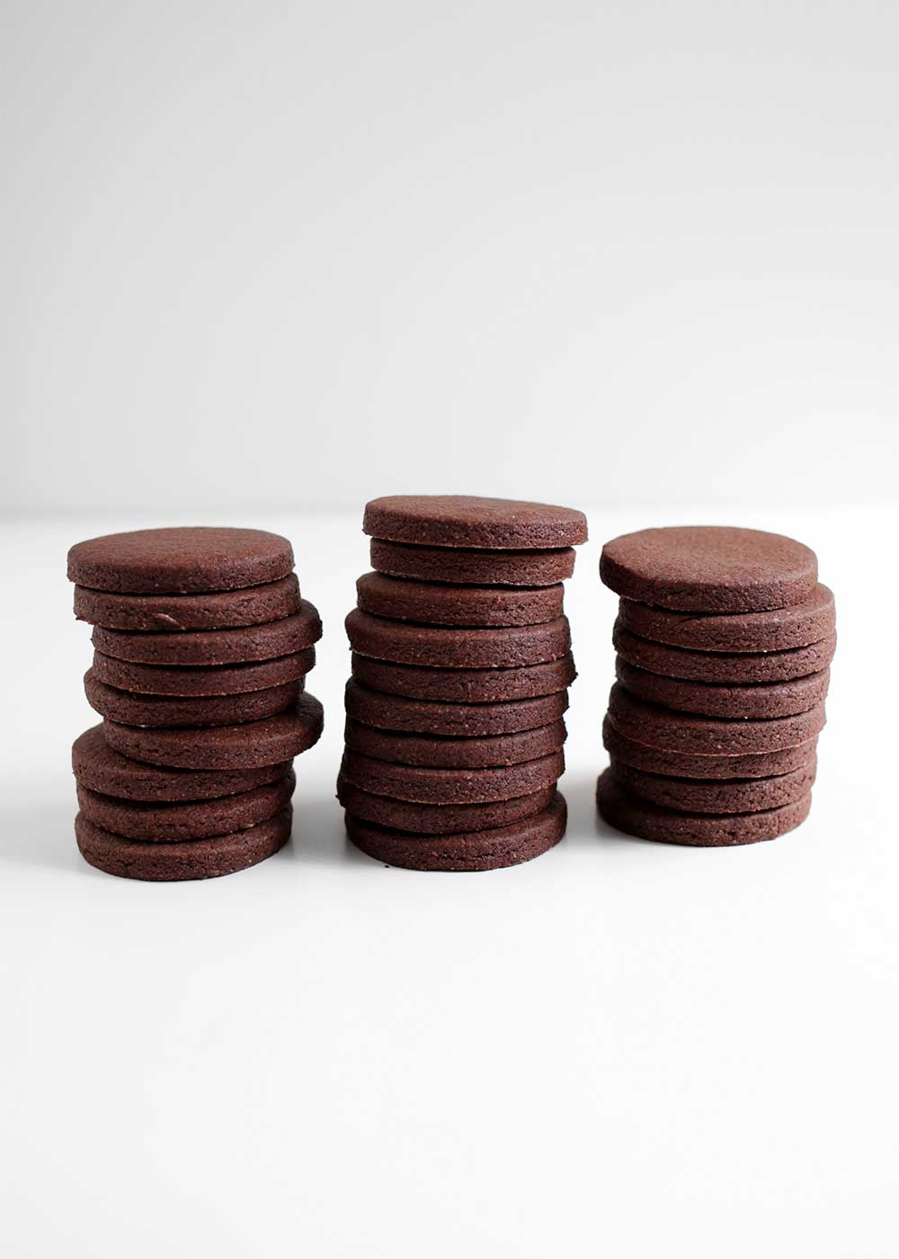 piles of Chocolate Cardamom Rye Cut-Out Cookies from the faux martha