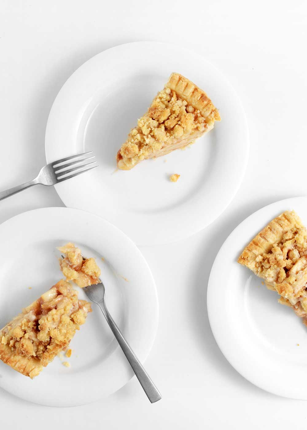 slice of almond apple pie with a crumble from the faux martha