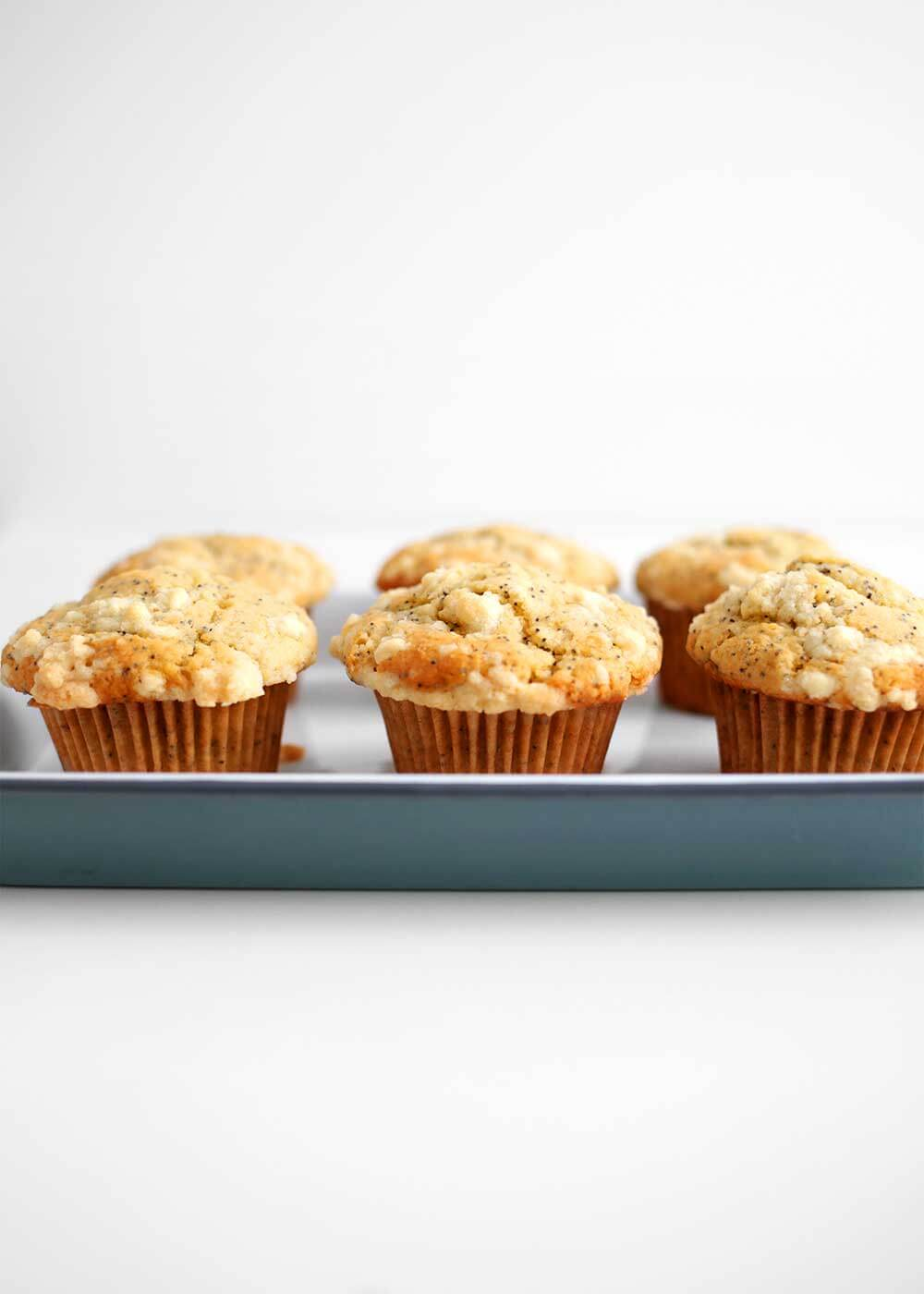 healthy lemon poppy seed muffins on a tray from the faux martha