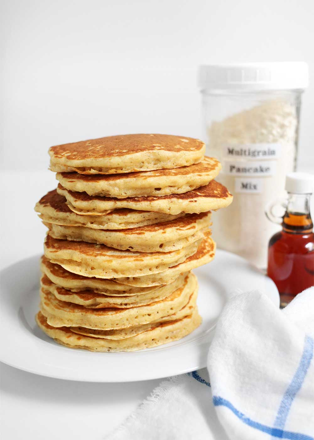 stack of Fluffy Multigrain Pancake mix from the faux martha
