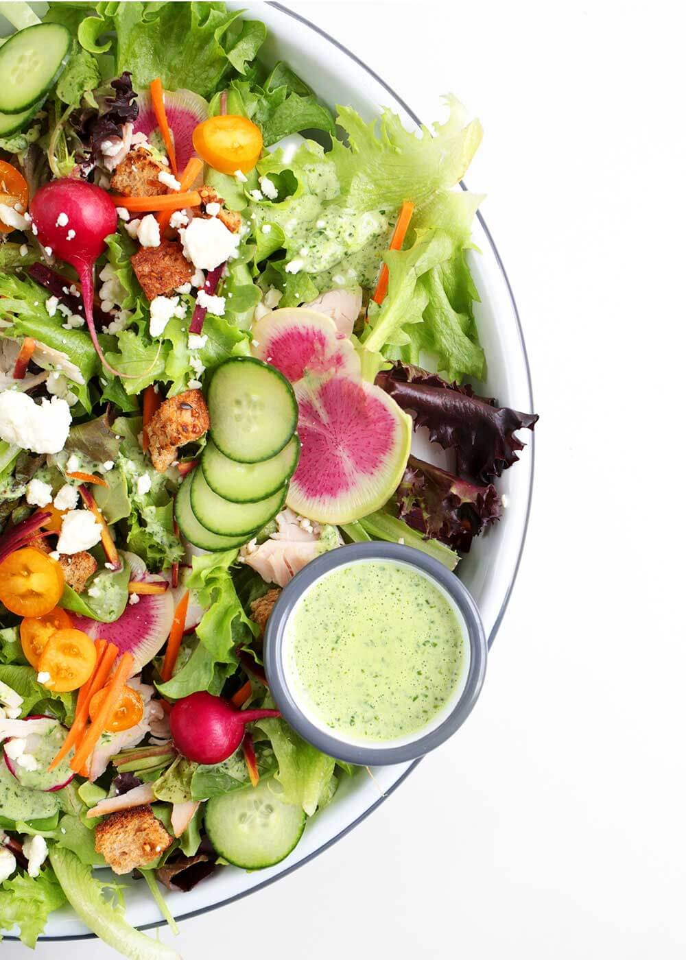 pantry friendly green goddess dressing in salad bowl from the faux martha